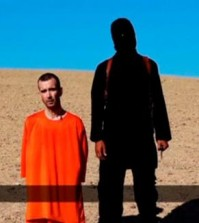 A still image taken from a purported Islamic State video of British captive David Haines before he is beheaded