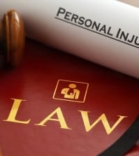 Inspector. Graphic logo is my artwork. Thanks.  Red leather Personal Injury Law book and gavel with gold embossed type and stylised icon of figure with arm in a sling embossed on the book cover and a Personal Injury writ.