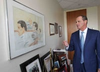 Brian McMonagle with a portrait of himself as a young prosecutor: Image: Philly.com