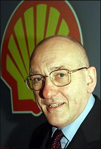 Shell Chairman Sir Philip Watts is considering legal action to reclaim his reputation after regulators dropped its investigation into his actions.