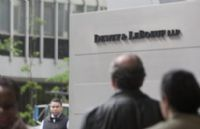 Troubled Dewey & LeBoeuf could be headed for collapse as the starkest signs yet of the firm's woes emerged with an announcement on Friday that there could be layoffs and with the issuing of a WARN Act notification that could preceed mass layoffs. 2